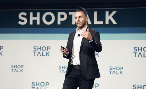Pouya Boland speaking at Shoptalk. Image courtesy of Chiquelle.